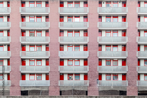 Papiers peints Londres Housing block faced with panels in red colour at golden lane estate in London