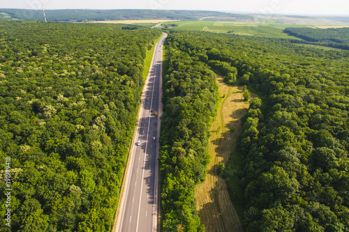 Dron View on Road Along Forest