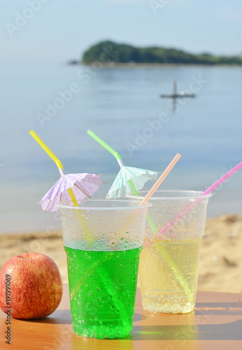 Two glasses of drink. Vacation on the sea.