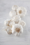 Fresh garlic decorated on a white wooden kitchen plate can be used as background - 191991670