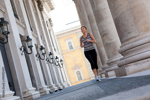 Fotobehang Hardlopen Mature Woman Jogging In The City
