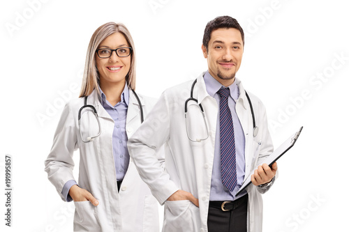 Female doctor and a male doctor with a clipboard