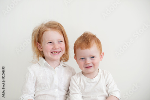 A girl with dental caries and a boy with a scratch on her nose