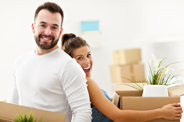Happy adult couple moving out or in to new home