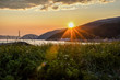 beautiful sunset over Tadoussac bay and grassy field