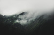 Low lying cloud and fog rolling in on a mountain - 192011253