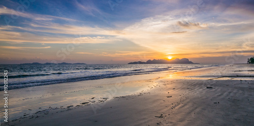 Foto op Canvas Zee zonsondergang The golden hours beach