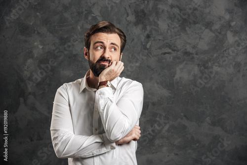 Tired bearded businessman