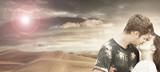 coppia di innamorati che si bacia nel deserto - 192020067