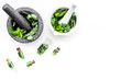 Phytotherapy. Herbs in mortar bowl and in small glasses on white background top view copy space
