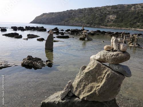 Fotobehang Zen stones balanced on the beach, Rhodes, Greece