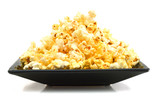fresh popped popcorn isolated in black plate on white background - 192035689
