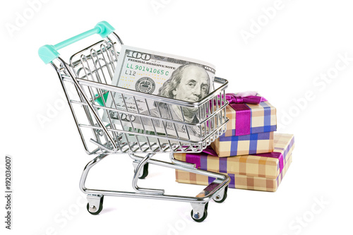 A supermarket trolley with dollars and purchases