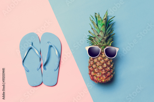 pineapple on colored paper with glasses - 192039441