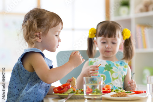 children eating food in daycare centre