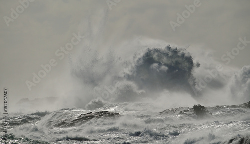 Fotobehang Grijs Rough sea and big wave when breaking against the rocks, coast of Gran canaria