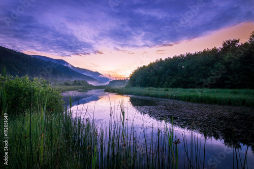 Fotobehang Bergrivier Sunset over the river