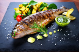 Grilled trout with potato and spinach - 192052083