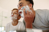 Funny father and son shaving in bathroom - 192053025