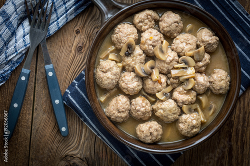 Foto op Canvas Bol Delicious homemade swedish meatballs with mushroom cream sauce. Small depth of field. Top view.