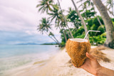 Fresh coconut water drink woman holding drinking on beach relaxation luxury holiday in Bora Bora, Tahiti, French Polynesia. Healthy natural refreshment on tropical vacation. - 192059656