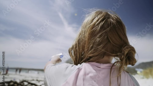 Two shots includes. Child flying kite on beach and kite in the sky. 50p