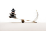 Stone balance with plume. Concept of hard and easy. - 192064231