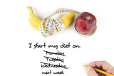 Diet, healthy eating, food and weigh loss concept - close up of banana apple and measuring tape - 192067013