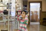 girl in   museum  near  exhibit with headphones. - 192067813