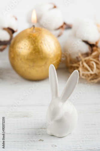 Easter rabbit, golden candle