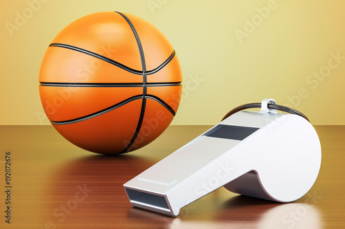 basketball-ball-with-whistle-on-the-wooden-table-3d-rendering