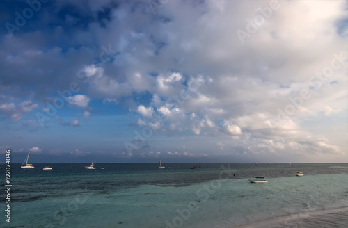 Poster Zanzibar Dawn over the ocean. Boats and yachts in the coastal waters.