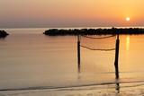 beach volleyball net on the beach at dawn - 192074899