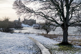 Linlithgow Palace and Loch and St Michael's Church in winter with snow; the birthplace of Mary, Queen of Scots; situated by Linlithgow Peel, West Lothian, Scotland. - 192078882