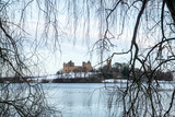 Linlithgow Palace and Loch in winter with snow; the birthplace of Mary, Queen of Scots; situated by Linlithgow Peel, West Lothian, Scotland. - 192079045