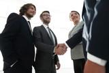 business people handshaking after good deal.