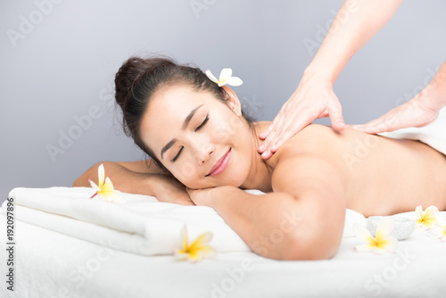 Fototapeta Spa and Thai massage, beautiful women relaxing and healthy of aromatherapy