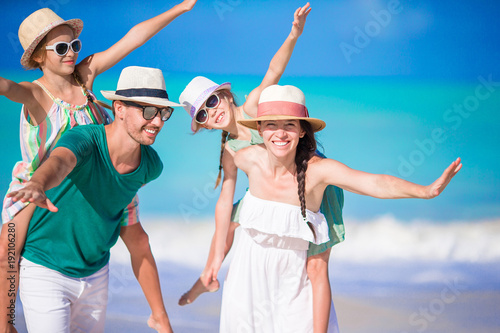 Portrait of happy family on the beach