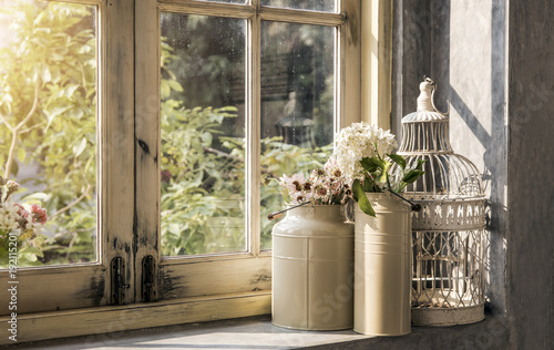 Foto Murales romantic decoration vintage style with flower watering stainless and steel bird cage