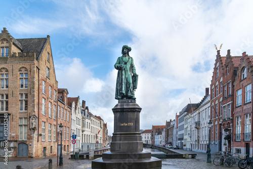 Fotobehang Brugge Statue of the Flemish painter Jan van Eyck in Bruges.