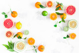 Fruit background. Colorful fresh fruits on white table. Orange, tangerine, lime, lemon, grapefruit. Flat lay, top view, copy space - 192125414