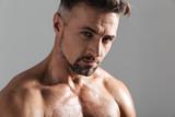 Close up portrait of a handsome muscular mature shirtless man - 192131830