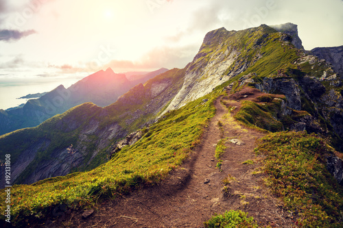 Fotobehang Diepbruine Mountain landscape with sunlight. Beautiful nature of Norway. Edge of a mountain