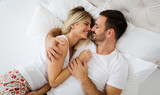 Young couple having having romantic times in bedroom - 192138842