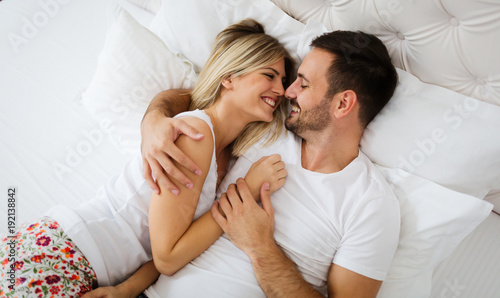 Zobacz obraz Young couple having having romantic times in bedroom