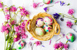 Easter eggs and colorful iris flowers on white textile - 192140497