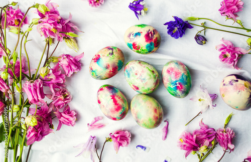 Sticker Easter eggs and colorful iris flowers on white textile
