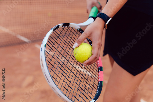 Fotobehang Tennis Tennis player. Close-up view of women's hand preparing to hit a ball, playing tennis on the court.