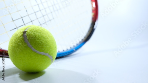 Fotobehang Tennis Tennis ball and racket over white background