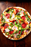 Pizza with Salami, Ham, Cherry Tomatoes and Jalapeno Pepper - 192157671